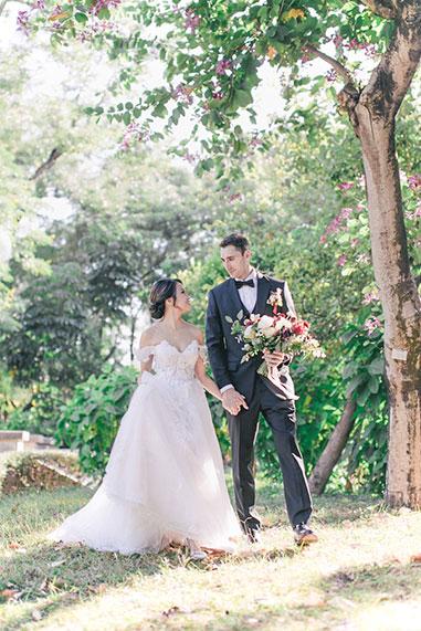 bride smiling walking with groom