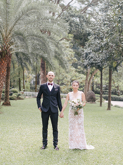 couple posing after wedding ceremony
