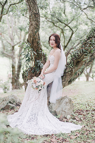 bride smiles in forest