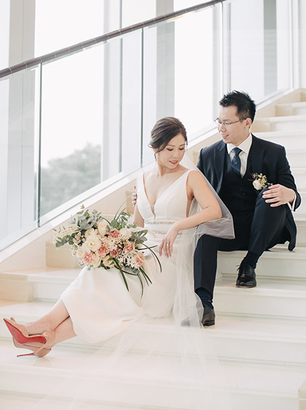 couple posing on stairs at a wedding