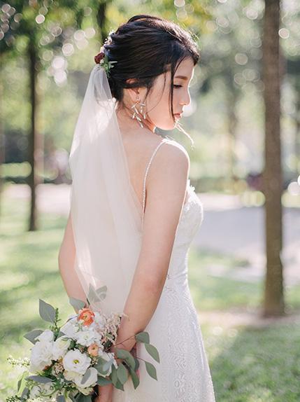 bride posing showing off wedding dress