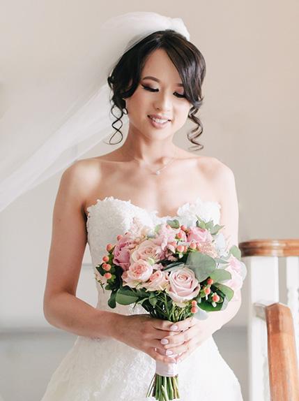 bride posing with wedding bouquet