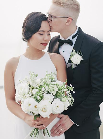 couple embracing in wedding dress and tuxedo