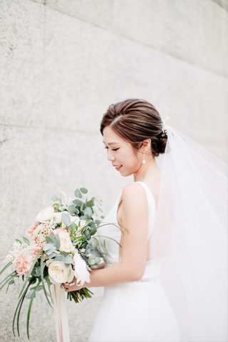 bride holds her floral bouquet on wedding day