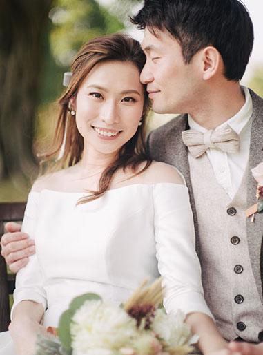 bride smiles at camera during wedding day