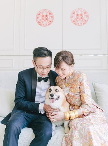 couple pose during wedding morning with dog