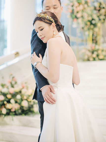 couple posing on stairs during wedding day
